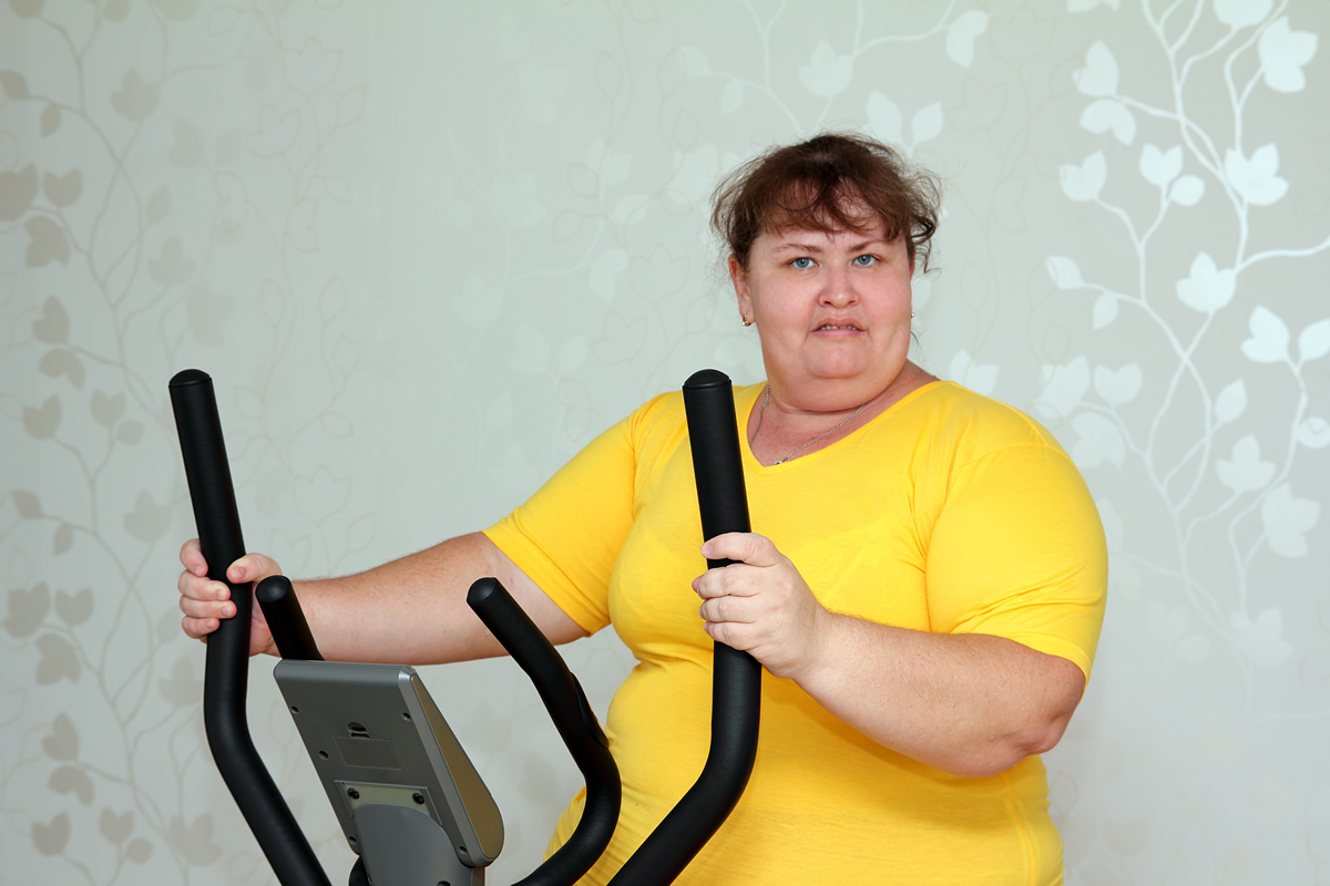 Bigstock Overweight Woman Exercising On 178816624